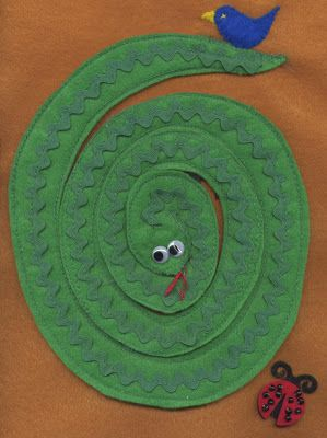 Snake quiet book page - the snake unfurls off of the page! It has a little velcro behind the head to keep nicely curled on the page in the meantime.
