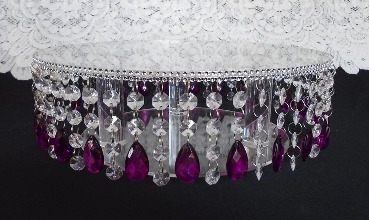 Acrylic crystal droplet design cake stand Sizes:6- 8-10-12- 14 - 16 - 18 20 round or square shape by 4.5 inches tall They also look great when used in between the cakes as well for a matching separator /stand look   please choose the items you require from the menu  Choose from many drop colours Drapes of faux clear acrylic crystal beads, accented with coloured droplet crystals Silver Crystal effect top plate edge with mirror top  Beautiful mirror finish top for maximum reflection and st...