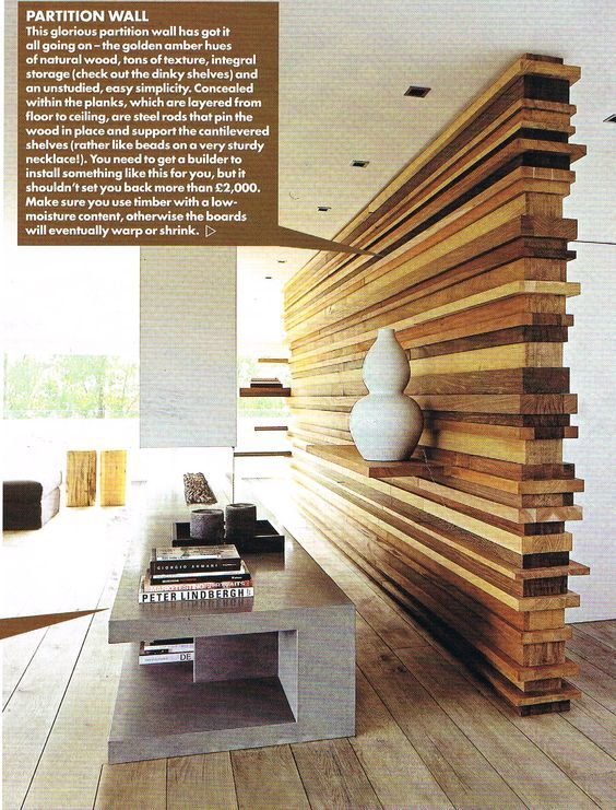 Stacked wood partition wall makes divided spaces neat and unique. No pattern is alike with a wall custom build ike this.: