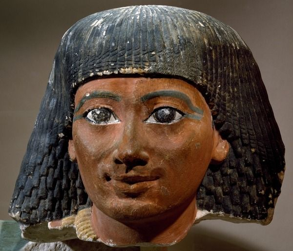Vizier Sennefer, detail from sculptural group depicting Sennefer with his wife Hatshepsut, painted stoneware, 68x85 cm. New Kingdom, 18th Dynasty. Now at the Louvre.