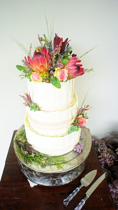 Decorated With Proteas Roses And Fynbos Covered In White