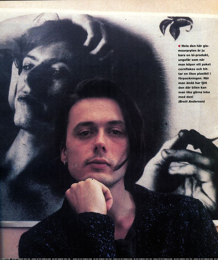 bret anderson in front of a david bowie poster