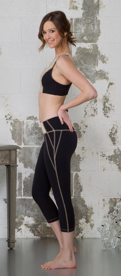 Nina B.Roze Moon Balance Yoga Capris designer of Heart Butt Leggings www.bestfitbybrazil.com perfected the classic black capri. The black Moon Balance capri has a unique style. These capris are made out of compression jersey, silver lame and nude mesh overlay. Allowing 3 fabrics on the front waistband, these capris tighten and flatten your stomach during your training. Poly nude fluffy thread is used for all outer flatlock stitching, allowing visibility of seams and shapes.
