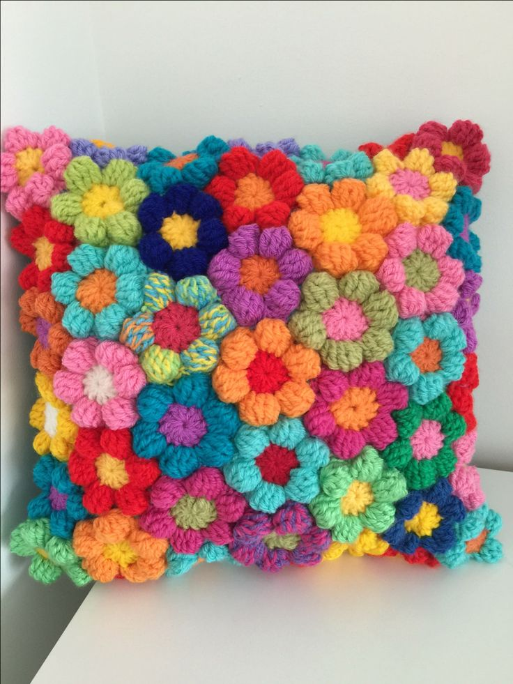 A personal favourite from my Etsy shop https://www.etsy.com/uk/listing/261817068/rainbow-flower-crochet-cushion-wool