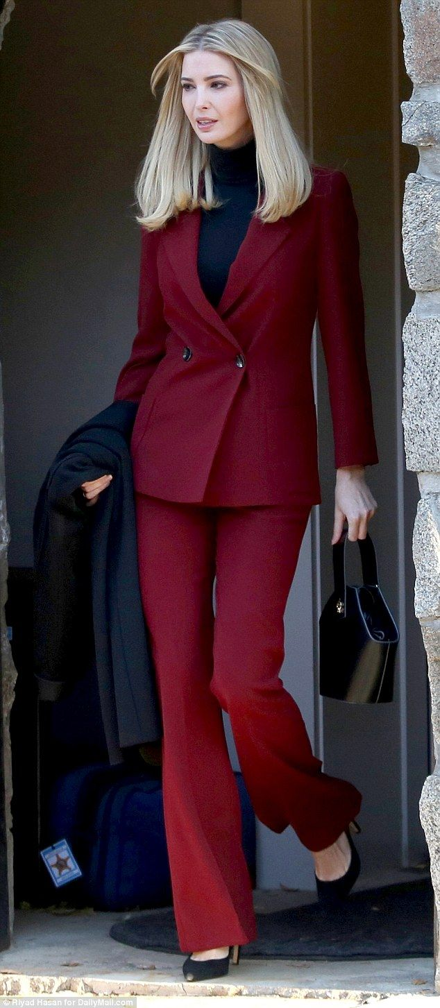What Ivanka Trump is wearing today. Dec 19 2017. Long hair down. Red scarlet double breasted pantsuit, black turtleneck, hand bag and coat. walking