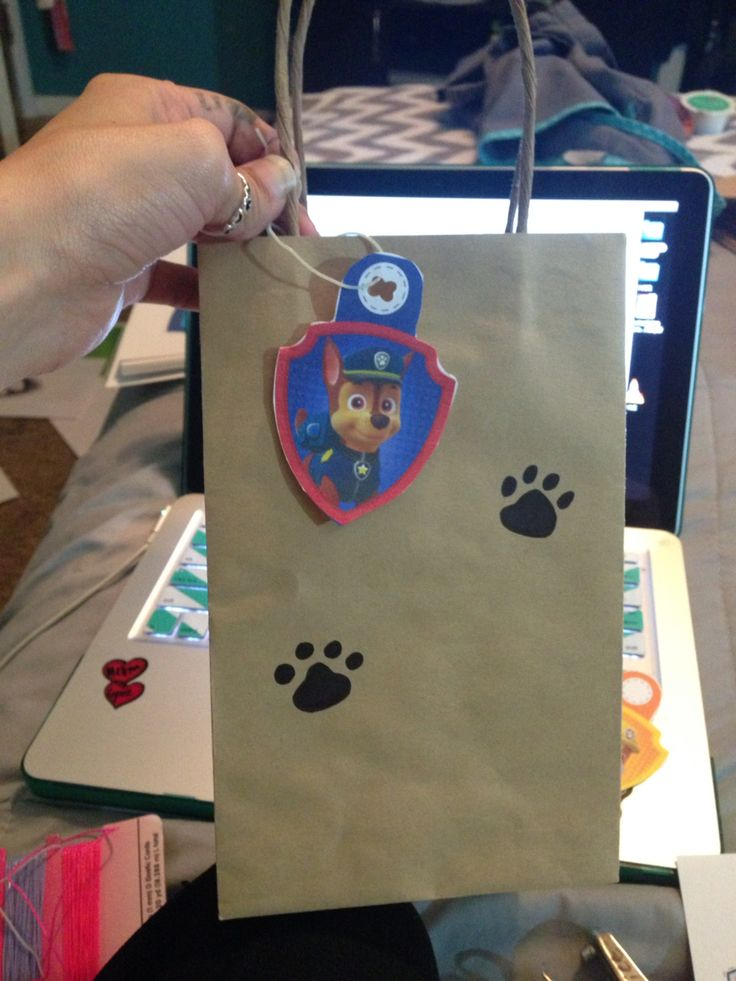 Paw Patrol good bags I drew on the paw prints used some print outs that I got off the nick jr website tied them on with some string ta da! Cute goodie bags