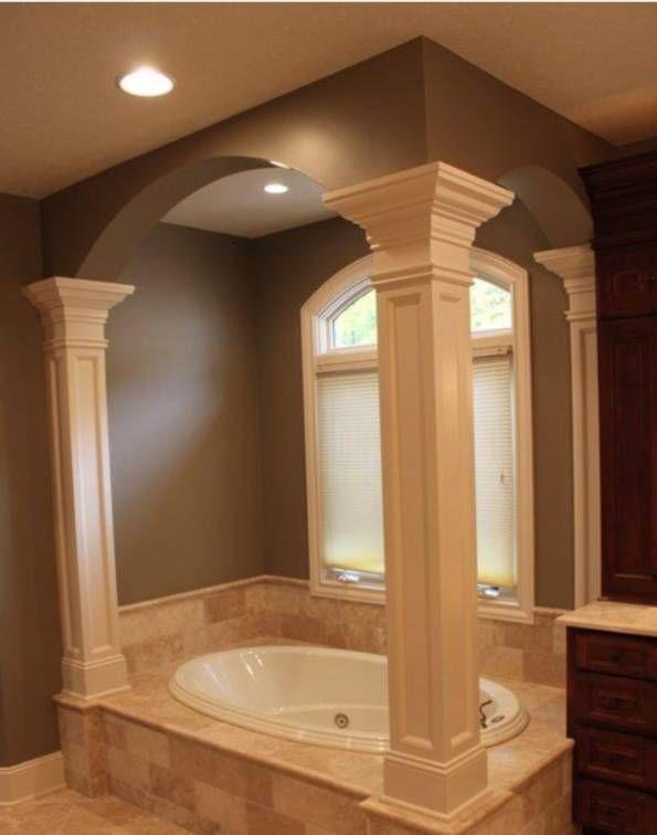 Pillars and posts around garden tub with ceramic tile for Garden tub bathroom ideas
