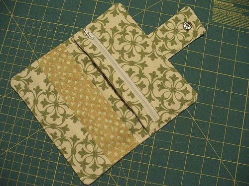 Free Sewing Tutorial for Organizer Wallet with snap tab closure, 6 credit card slots, zippered pocket, 2 full width inner slip pockets and outer zipper pocket.
