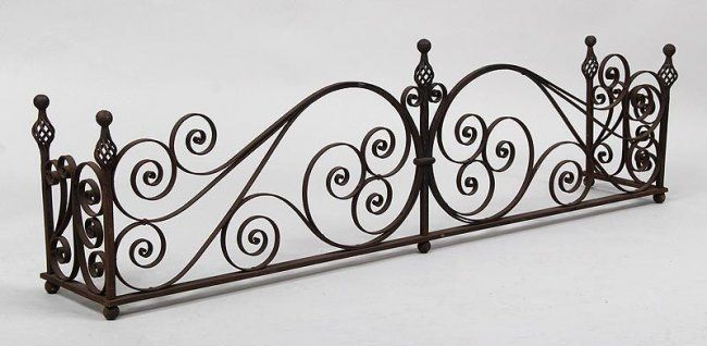 Wrought iron fireplace fender with open scroll work, : Lot 172