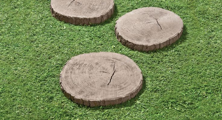 use tree stump stepping stones to mark an informal path
