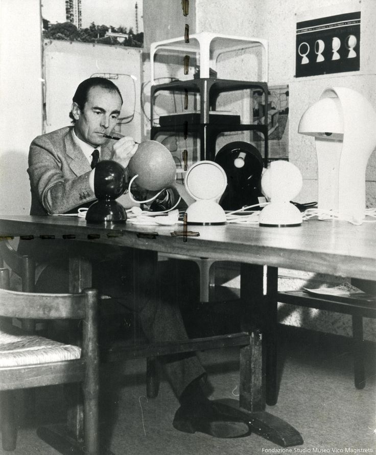 Vico Magistretti in his studio working on an Eclisse prototype.