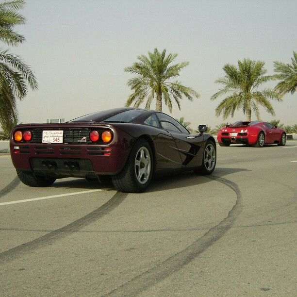 playful mclaren f1 and red bugatti in the background. Black Bedroom Furniture Sets. Home Design Ideas