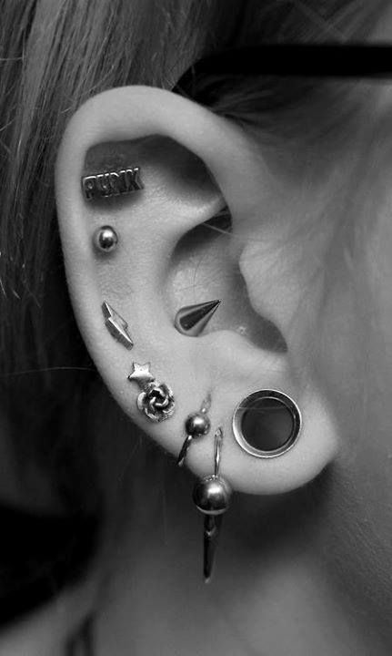 Right Ear ;; Lukah also has three small hoops above his left eyebrow. A barbell lives on each of his hips (with a two inch thick, three inch long solid black stripe tattoo under each). Finally, a dermal lies right between his clavicles. ((Ear piercings))