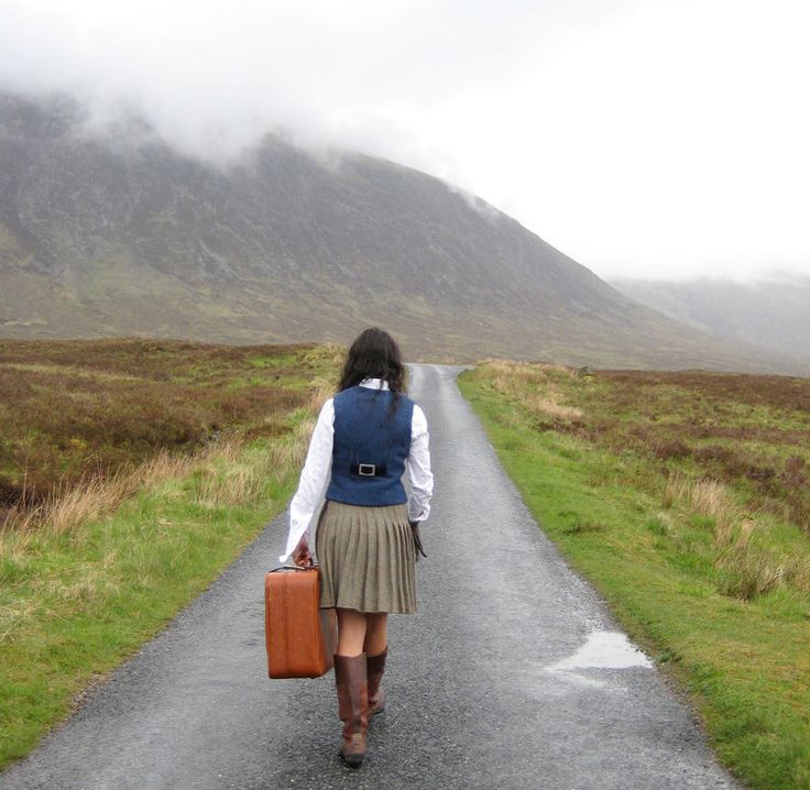 lady with suitcase, lady wearing kilt.  Handmade in the Scottish Highlands. www.lornagillies.com Atmospheric, haunting, dreamer inspiration. Rhu Kilt & Shiel Waistcoat. Outlander