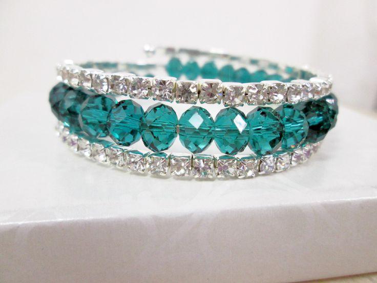 A personal favorite from my Etsy shop https://www.etsy.com/ca/listing/265036491/emerald-green-bridal-cuff-bracelet-multi