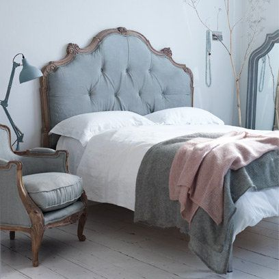 Grey upholstered headboard with white bedlinen lovely Light grey and navy bedroom