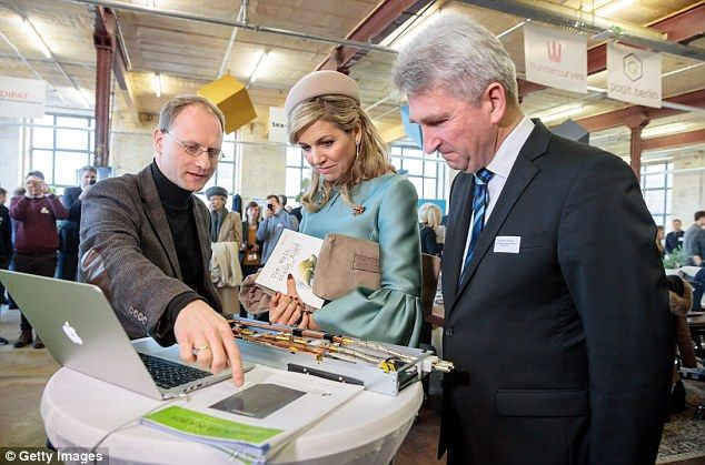 Queen Maxima Of The Netherlands, accompanied by Prof. Andreas Pinkwart of the HHL Leipzig Graduate School of Management, talks to a young entrepreneur during a visit to the Spinlab