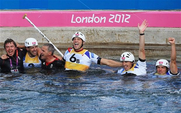 Great Britain defeats 3 time defending gold medalists to go 1, 2 in white water canoeing. The team and their coaches dove into the water to celebrate