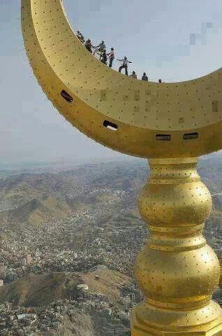 The crescent over the clock tower ( Makah - Saudi Arabia )