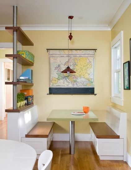 Map out a new color scheme with large-scale wall art. A great way to instantly bring a splash of color into the kitchen is with an oversize piece of art. It need not be precious to do the job; think topographical maps, vintage school charts and botanical illustrations.