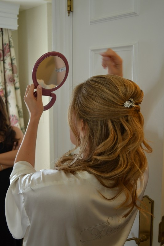 Half up half down subtle waves with pieces in front and volume at crown.  CREDIT: Jewel Hair Design: Julie Flury www.jewelhd.com  Photog: Jennifer Morris