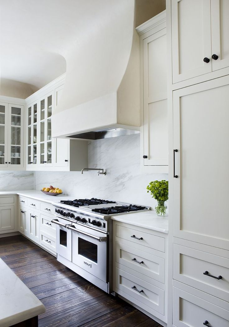Soft white, dark wood floor, marble backsplash