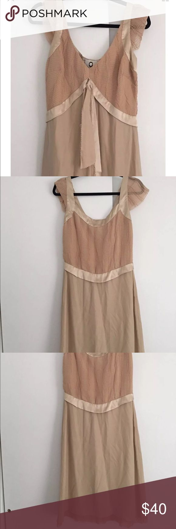 "Maybe silk nude dress sz 8 Flesh colored   cap sleeve   silk   raw hem detailing   raw silk edge detailing   satin trim   side zip   never worn   gorgeous feminine dress  Approximate measurements:   Bust: 38"" Waist: 28"" Hip: 40""  Length: 43"" Classic Mayle styling  vintage feel  lined  hits below knee  classic feminine silhouette  Maison Mayle Jane Mayle mayle Dresses"