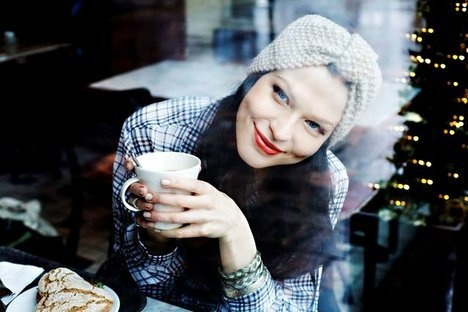 beautiful girl in a hat in a cafe at Christmas