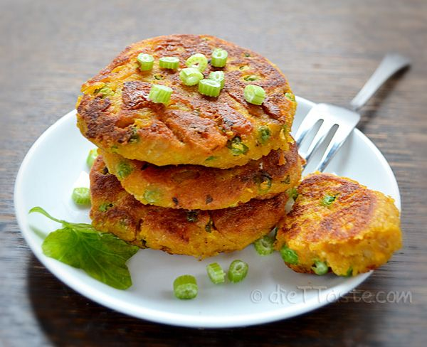 Chickpea And Sweet Potato Patties: 3/4 pound (800 g) sweet potatoes, peeled and diced 1 1/2 cup chickpeas (garbanzo beans), cooked 2 scallions, cut 1 clove garlic, crushed 2 teaspoons cumin seed 1 tablespoon fresh ginger root, grated 2 tablespoons lemon juice 1 teaspoon salt ground black pepper 3 tablespoons bread flour 6 tablespoons whole wheat flour 1 cup peas (no need to defrost)