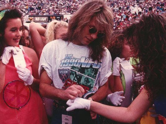 Jon Bon Jovi signing autographs