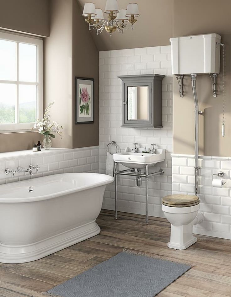 Traditional bathroom with roll top bath, chrome frame ...