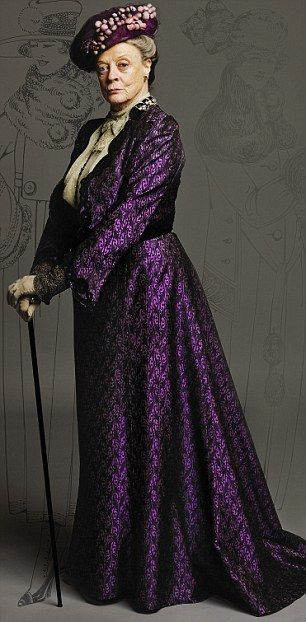 This outfit was made for Maggie Smith as Violet in Downton Abbey. The fabric was created by reproducing an Edwardian print onto silk. The design was based on a jacket from the era.