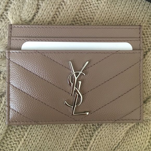 ❤️Saint Laurent card holder in Tan❤️ Absolutely beautiful YSL card holder in tan color with silver logo. 100% authentic and Brand new with tags and box!! No Trade!! Saint Laurent Accessories Key & Card Holders