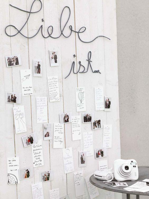 Kreative Gästebuch-Alternative mit Schnappschüssen aus der Sofortbildkamera und lieben Grüßen