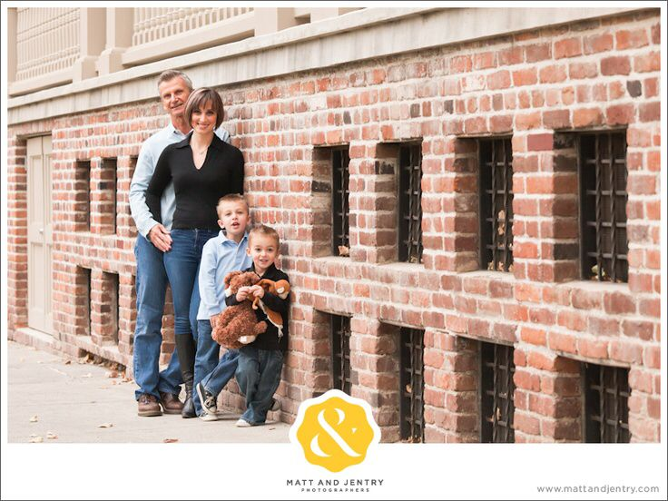 Reno family photography at unr with reno family photographer matt and jentry by brick wall