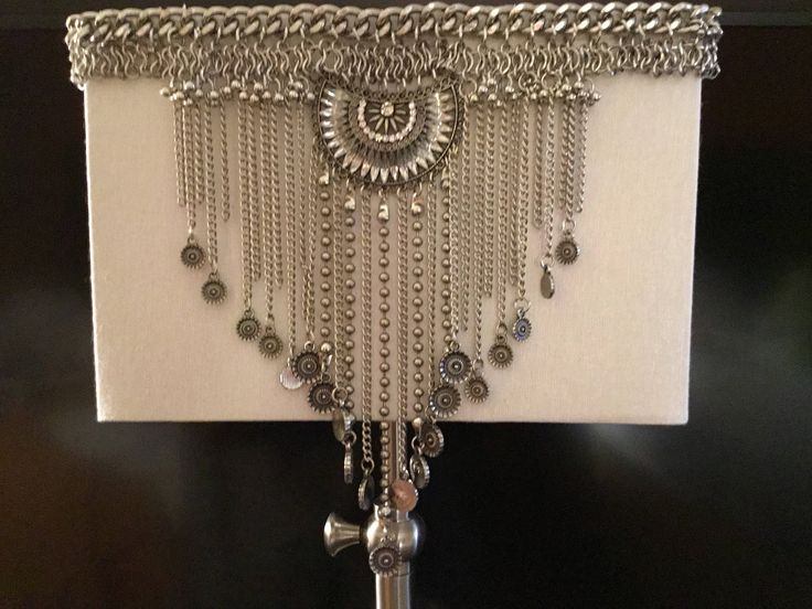 A personal favorite from my Etsy shop https://www.etsy.com/listing/528842545/bold-chain-and-gem-lamp