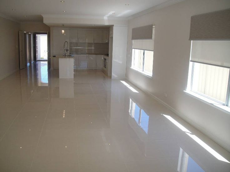 Polished grey porcelain floor like the combo of this White kitchen floor tile ideas