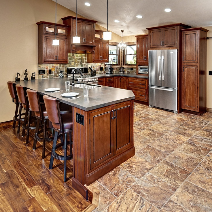 The kitchen cabinets are the fairmont inset style from for Cherry kitchen cabinets with glass doors