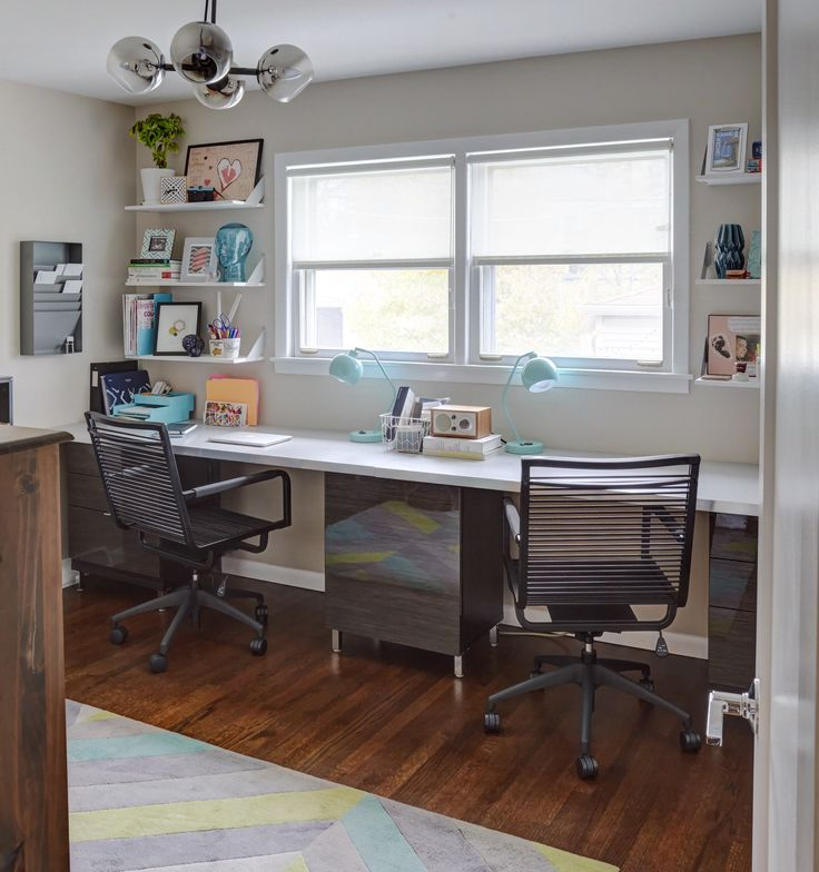 Carly uses one of the bedrooms upstairs as her office, which is furnished with Ikea desk tops that fit the extent of the wall.