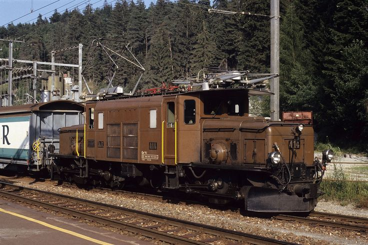 Ge 6/6 I 414 hauling freight train 5771 from Landquart to Ilanz is waiting for the departure time from the station of Reichenau-Tamins.