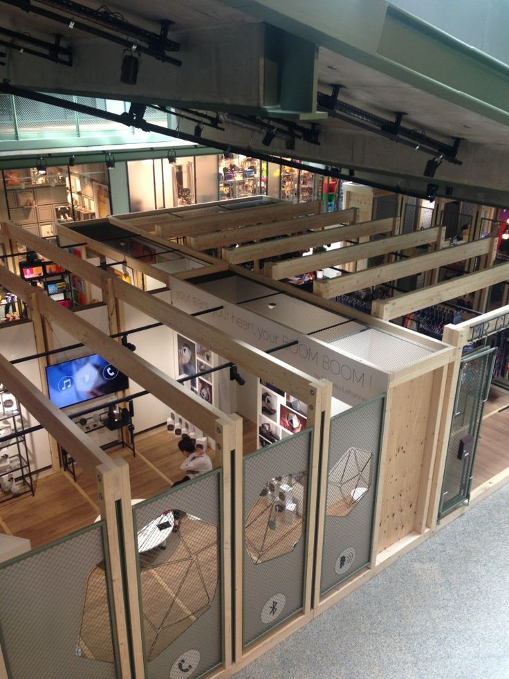 bikini berlin shopping mall - beautiful industrial interior design with honest metal and wood material language, including these pop up retail units.