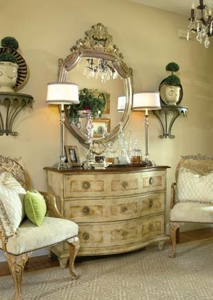 Beautiful and interesting vignette. The chairs are so gorgeous. The brackets are certainly different.