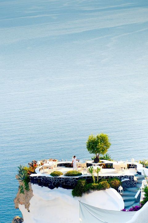 A gorgeous wedding setup overlooking the blue water in Greece
