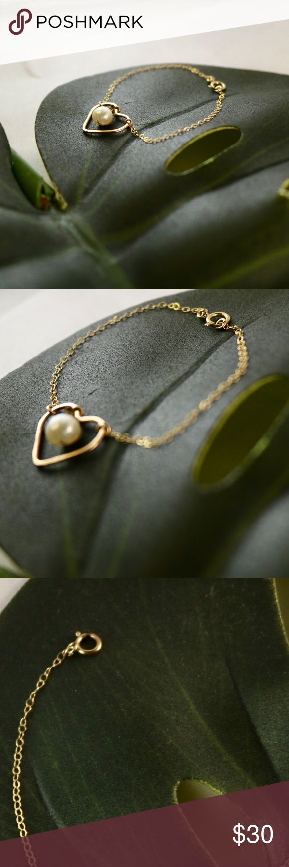 •Gold Heart Pearl Bracelet• Real Gold chain and welded heart with fresh water pearl that dangles from the center and lobster clasp. Jewelry Bracelets