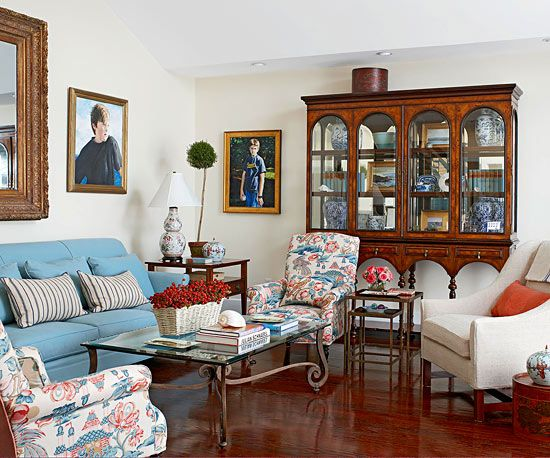 A floor that sparkles and shines is just one unusual but beautiful element in this timeless living room. An assortment of antiques maintain a traditional aesthetic, as do colors and palettes. A chinoiserie print on the accent/