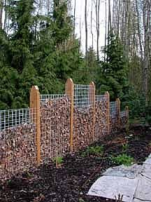 Compost fence - intriguing idea for permaculture garden. The fence itself can be planted for a living screen.