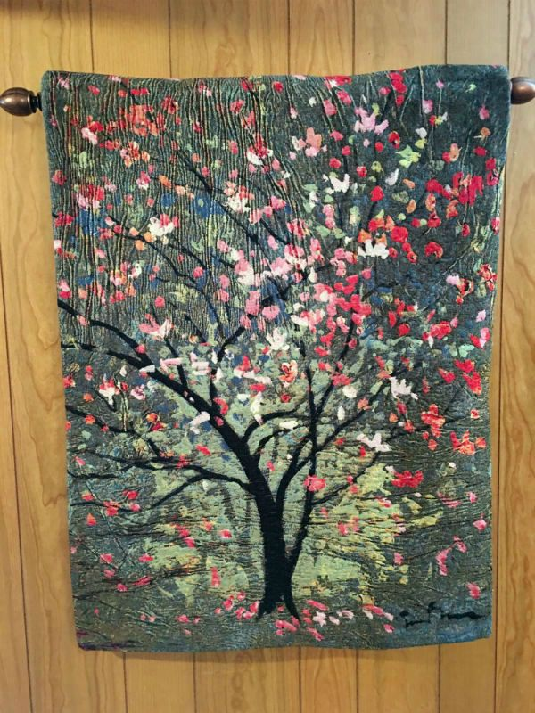 Simon Bull Hopeful Tree tapestry hanging in an office