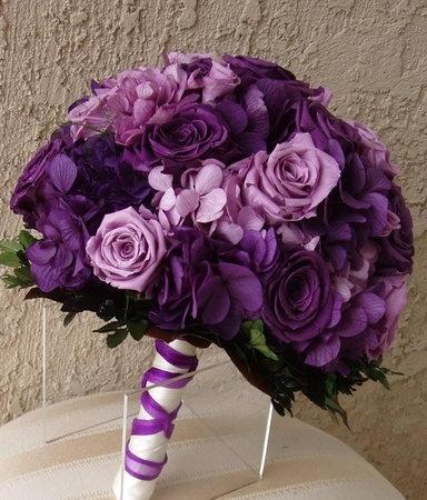purple theme wedding flowers