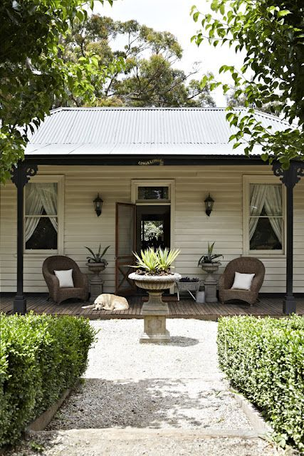 white weatherboard cottage