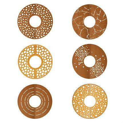 ronde corten boomroosters met diverse grafische patronen